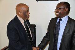 JMEC Chairperson H.E. Festus Mogae greets NCAC Chairperson Mr. Gichira Kibara